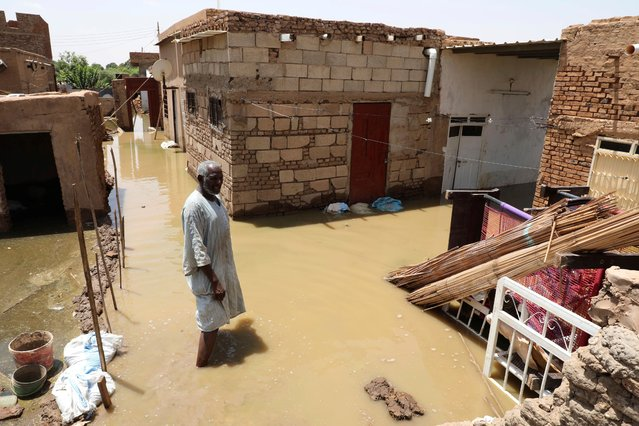 A man passes on the side of a flooded road in the town of Alkadro, about (20 km) north of the capital Khartoum, Sudan, Saturday, September 5, 2020. Sudanese authorities have declared their country a natural disaster area and imposed a three-month state of emergency across the country after rising floodwaters and heavy rainfall killed people and inundated over 100,000 houses since late July. (Photo by Marwan Ali/AP Photo)