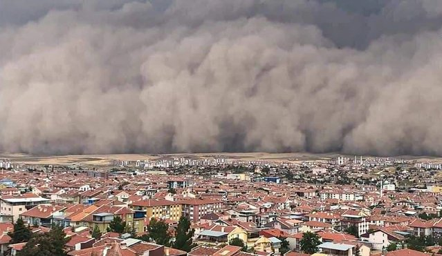A handout TV grab made available by the Demiroren News Agency (DHA) on September 12, 2020, shows a freak sandstorm sweeping over Polatli, in Ankara, on September 12, 2020. A freak sandstorm hit Ankara on September 12, 2020, the Turkish capital's mayor said, as officials said six people were injured after strong winds. (Photo by Handout/DHA via AFP Photo)