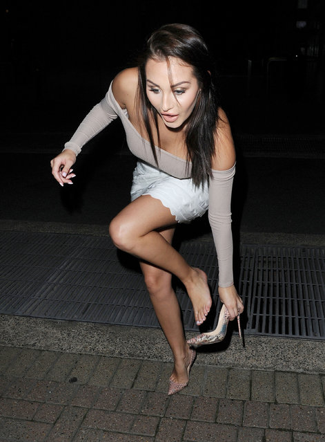 "UK ""Ex On The Beach"" star Chloe Goodman had a huge fashion disaster at a London Fashion Week event in Chelsea last night September 21, 2016, when her Christian Louboutin heel got caught in a metal grate. The former Celebrity Big Brother housemate looked embarrassed whilst trying to get her heel back after the disaster as well as cupping her top to avoid a second wardrobe malfunction. (Photo by XposurePhotos.com)"