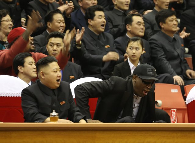 North Korean leader Kim Jong Un, left, and former NBA star Dennis Rodman watch North Korean and U.S. players in an exhibition basketball game at an arena in Pyongyang, North Korea, Thursday, February 28, 2013. Rodman arrived in Pyongyang on Monday with three members of the Harlem Globetrotters basketball team to shoot an episode on North Korea for a new weekly HBO series. (Photo by Jason Mojica/AP Photo/VICE Media)