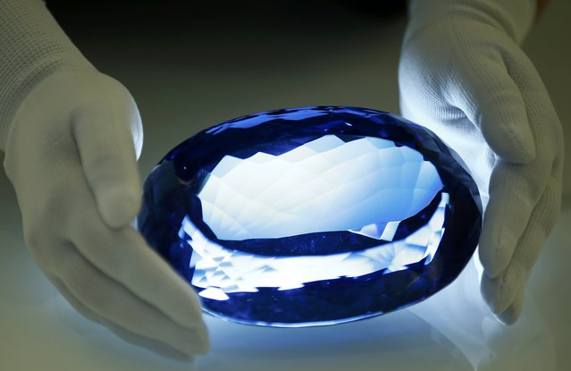 The largest known blue topaz stone, owned by philanthropist Maurice Ostro, is displayed to media at the Natural History Museum in London, Britain September 27, 2016. (Photo by Peter Nicholls/Reuters)