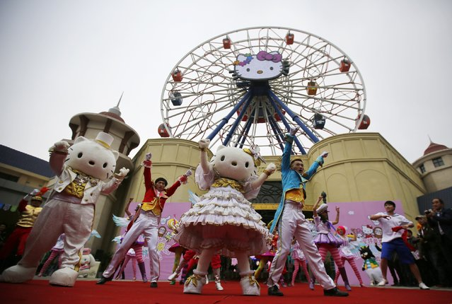 Dancers perform during an inauguration ceremony of a Hello Kitty amusement park in Anji, Zhejiang province November 28, 2014. (Photo by Carlos Barria/Reuters)