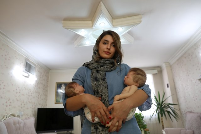 "Twenty-four-year-old Maryam Aghayee makes hyper-realistic baby dolls acting as surrogates for some Iranian families who are apprehensive of having more children. ""It has been about three or four months since I started this work"", says Maryam in Tehran, Iran on October 7, 2020. ""After making my second doll, many orders have been coming in. The second doll was much more realistic than the previous one. After making my second doll, I said that from now on I can take customer orders. I did not intend to start a business from the beginning because it was a hobby, but after the second doll, the demand for these kinds of dolls increased, customers want to have such dolls"". (Photo by Majid Asgaripour/WANA (West Asia News Agency) via Reuters)"