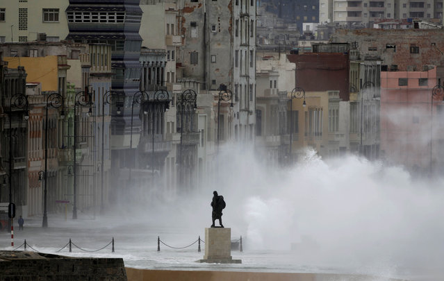 In this March 3, 2010, file photo, the monument of Venezuelan independence hero Francisco de Miranda is seen as waves splash on Malecon avenue in Havana. The foreigners visiting Havana used to be Canadians and Europeans on cheap beach package tours and left-leaning Americans on dutiful rounds of organic farms and neighborhood health clinics. (Photo by Javier Galeano/AP Photo)
