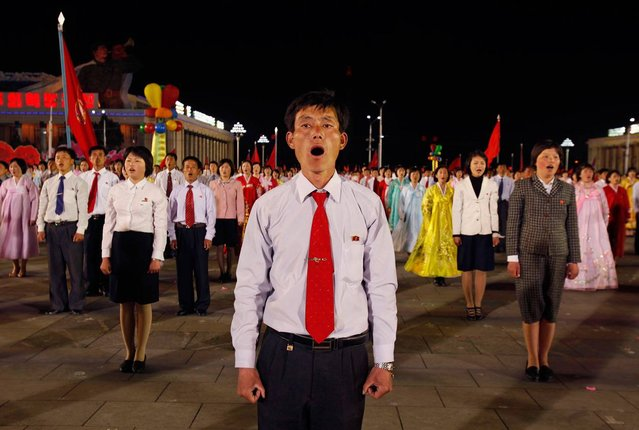 Dancers stand in formation and sing in a gala show in Pyongyang, on April 16, 2012. The performance was part of the celebration on the centenary of the birth of Kim Il Sung. (Photo by Bobby Yip/Reuters)