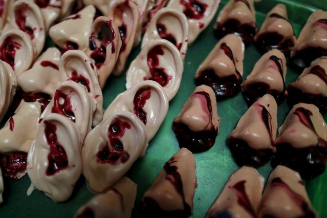 Bloody ears and noses made of gummy candy and red jelly are pictured at the Zombie Gourmet homemade candy manufacturer  on the outskirts of Mexico City October 30, 2015. (Photo by Carlos Jasso/Reuters)
