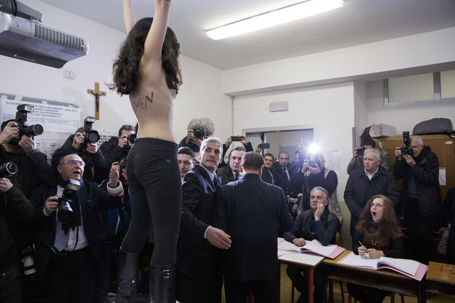 Silvio Berlusconi, President of Forza Italia (Go Italy) and former Italian Prime Minister, holds his ballot before casting his vote at a polling station on March 4, 2018 in Milan, Italy. The economy and immigration are key factors in the 2018 Italian General Election after parliament was dissolved in December 2017. Campaigning on the right are Silvio Berlusconi of Forza Italia teaming up with Matteo Salvini of the Eurosceptic Lega. While on the centre-left is Matteo Renzi, leader of the Democratic Party. Challenging both camps is the leader of the Five Star Movement, Luigi Di Maio. (Photo by Emanuele Cremaschi/Getty Images)