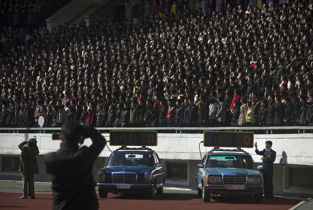 Cars with timing clocks wait for the start of a marathon to begin at Kim Il Sung Stadium in Pyongyang on Sunday, April 14, 2013. North Korea hosted the 26th Mangyongdae Prize Marathon to mark the upcoming April 15, 2013 birthday of the late leader Kim Il Sung. (Photo by David Guttenfelder/AP Photo)
