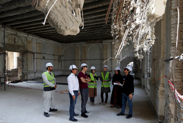Afghan engineers discuss inside the ruined Darul Aman palace in Kabul, Afghanistan October 2, 2016. (Photo by Mohammad Ismail/Reuters)