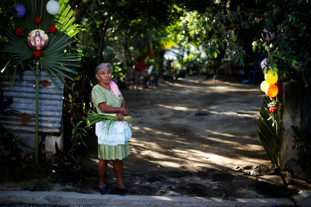 A woman waits for the Palm Sunday procession in Panchimalco, El Salvador March 25, 2018. (Photo by Jose Cabezas/Reuters)