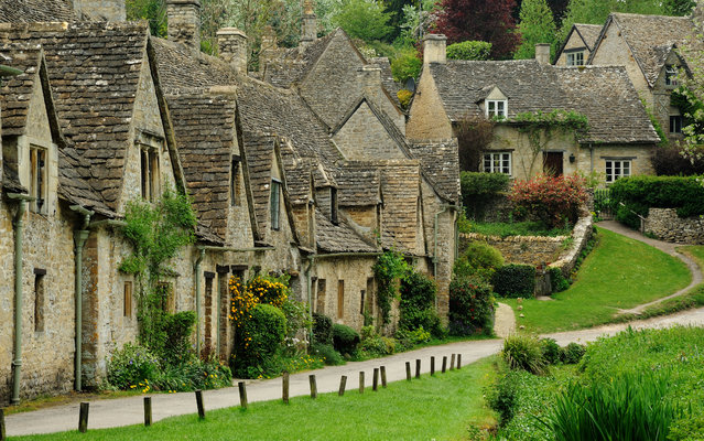 Arlington Row, Bibury, UK was built in 1380 as a monastic wool store. The buildings were converted into weaver cottages in the 17th century. (Photo by Saffron Blaze)