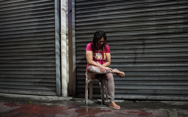 A woman grieves as a family member was shot by unknown assianlants on a street on October 10, 2016 in Manila, Philippines. The Duterte administration shifted to the next phase on its war on drugs after the first 100 days of President Rodrigo Duterte as over 3,700 people have been killed while more than 700,000 drug dependents surrendered to authorities. (Photo by Dondi Tawatao/Getty Images)