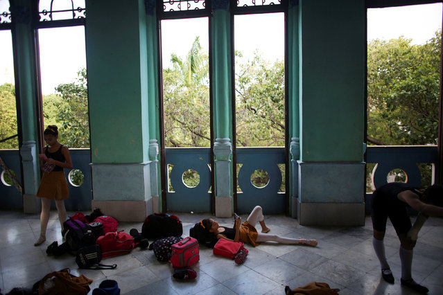 Students at the Cuba's National Ballet School (ENB) relax during a break in Havana, Cuba, October 12, 2016. (Photo by Alexandre Meneghini/Reuters)