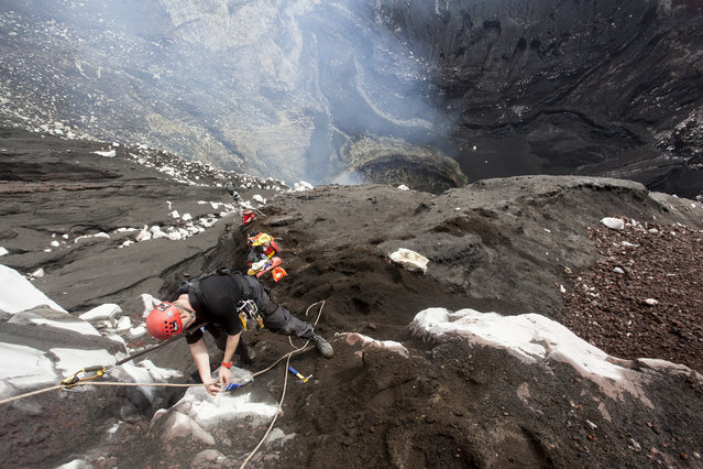Intrepid explorers descend into Marum Volcano in Vanuatu. (Photo by Bradley Ambrose/Caters News)