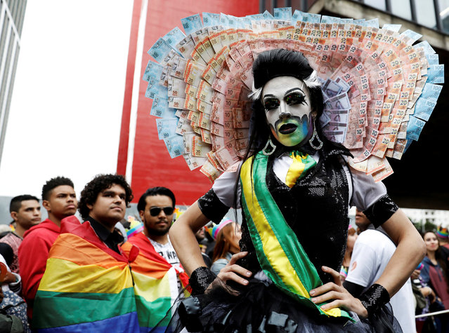 A reveller takes part in the Gay Pride parade along Paulista Avenue in Sao Paulo, Brazil on June 3, 2018. (Photo by Nacho Doce/Reuters)