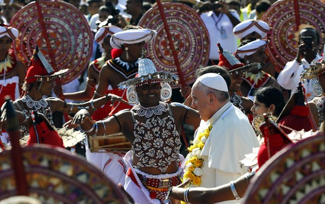 Pope Francis is greeted as he arrives at the Colombo airport January 13, 2015. Pope Francis said on Tuesday Sri Lanka needed to find out the truth of what happened during its long civil war in order to consolidate peace and heal scars between religious communities. (Photo by Stefano Rellandini/Reuters)
