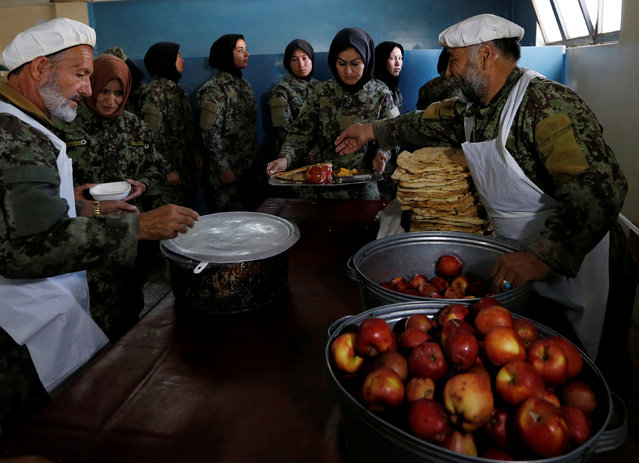 Afghan National Army (ANA) soldiers collect their lunch at the Kabul Military Training Centre (KMTC) in Kabul, Afghanistan October 23, 2016. (Photo by Mohammad Ismail/Reuters)