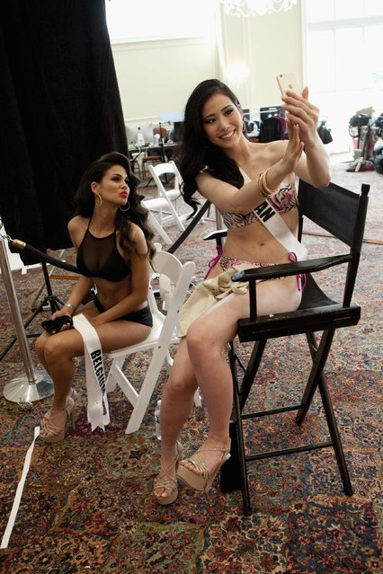 Miss Belgium 2014 Anissa Blondin and Miss Japan 2014 Keiko Tsuji (R) take a selfie at the Trump National Doral Miami resort, Florida, in this January 9, 2015 handout photo provided by the Miss Universe Organization. (Photo by Richard D. Salyer/Reuters/Miss Universe Organization)