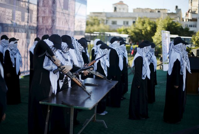 Palestinian girls demonstrate their skills with AK-47 rifles as they attend a Hamas women's rally in Gaza City December 6, 2015 in support of Palestinian stabbing attacks against Israelis. (Photo by Suhaib Salem/Reuters)