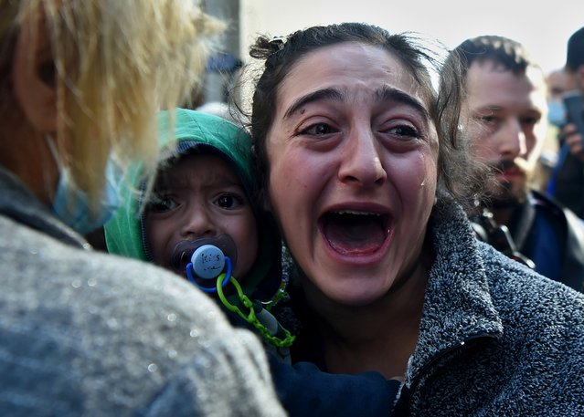 A woman holding a child reacts during an opposition rally to demand the resignation of Armenian Prime Minister Nikol Pashinyan following the signing of a deal to end the military conflict over the Nagorno-Karabakh region, in Yerevan, Armenia on November 11, 2020. (Photo by Lusi Sargsyan/Photolure via Reuters)