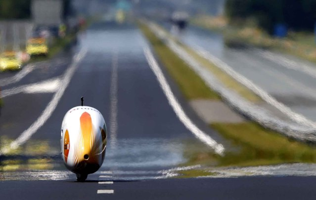 Netherlands' biker Sebastiaan Bowier takes part in a bike speed record attempt event, with his aerodynamic bike Velox3, on the A31 highway between the Dutch cities of Franeker and Dronrijp, the Netherlands, on July 9, 2013. The recumbent bicycle achieved a speed of 78.8 km per hour. (Photo by AFP Image/Forum)