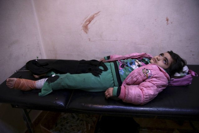 An injured student rests inside a field hospital after what activists said were air and missile strikes in the Douma neighborhood of Damascus, Syria December 13, 2015. (Photo by Bassam Khabieh/Reuters)