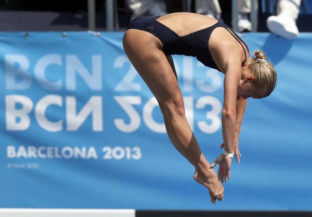 Luliia Prokopchuk from Russia performs during the women's 10-meter platform preliminary at the FINA Swimming World Championships in Barcelona, Spain, Wednesday, July 24, 2013. (Photo by Michael Sohn/AP Photo)