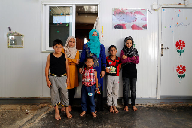 Rasha Inha, 30, the Syrian widow of a rebel fighter, poses for a photograph with her children in Zaatari camp in Jordan, October 14, 2016. Inha's husband was killed during fighting againt forces loyal to Syria's President Bashar al-Assad in Sahnaya, near Damascus. (Photo by Ammar Awad/Reuters)