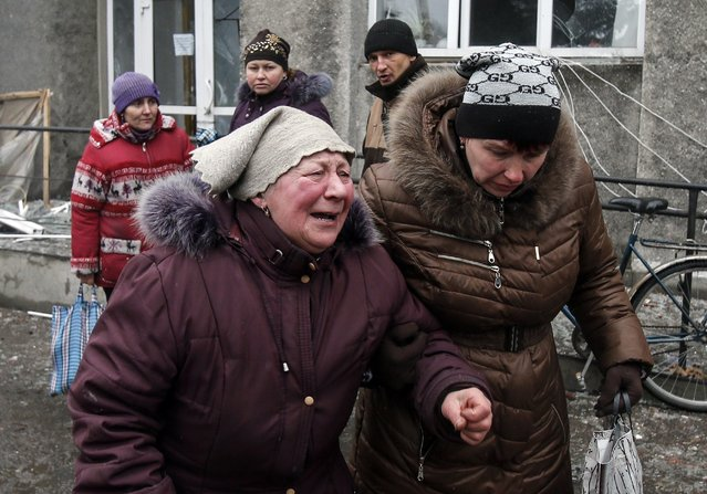 A woman reacts as she waits for humanitarian aid in front of a delivery point in the Ukrainian forces-controlled town of Debaltseve, Donetsk region February 6, 2015. (Photo by Maxim Shemetov/Reuters)