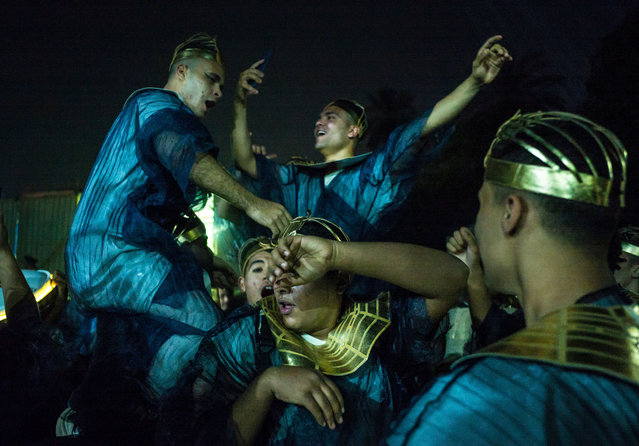 """Members of the """"Pharaohs' Golden Parade"""" show celebrate just after the finishing of the show on April 3, 2021 in Cairo, Egypt. (Photo by Vassilis A. Poularikas/NurPhoto/Rex Features/Shutterstock)"""