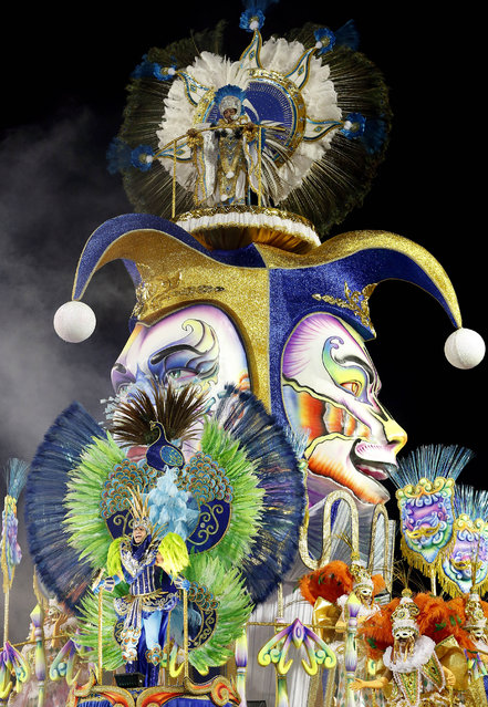 Dancers from the Academicos do Tucuruvi samba school perform on a float during the Carnival parade at the Sambodromo in Sao Paulo, Brazil, Friday, February 13, 2015. (Photo by Andre Penner/AP Photo)
