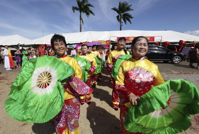 Surinamese citizens of Chinese origin participate in Chinese New Year celebrations at a joint banquet and temple fair in Paramaribo, February 19, 2015. (Photo by Ranu Abhelakh/Reuters)