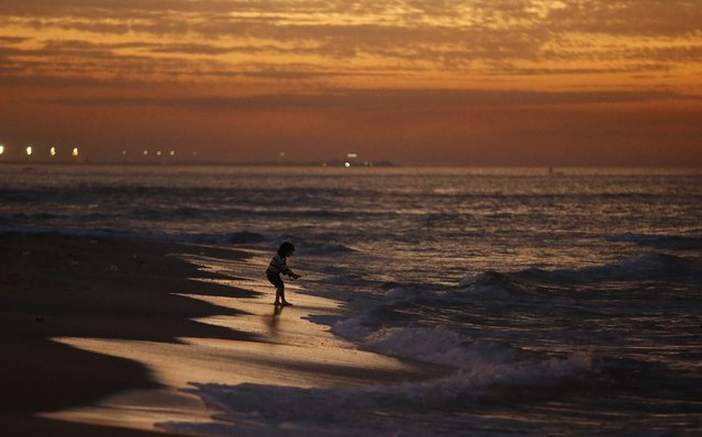 A Palestinian girl plays on the beach of Gaza City after sunset, February 6, 2015. (Photo by Mohammed Salem/Reuters)