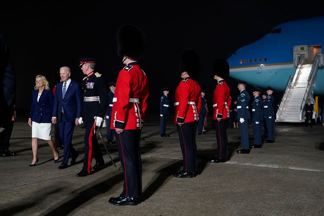 President Joe Biden and Jill Biden are escorted by Colonel Edward Bolitho, Lord Lieutenant of Cornwall, after stepping off Air Force One at Cornwall Airport Newquay, Wednesday, June 9, 2021, in Newquay, England. The Bidens are en route to the G-7 summit in Carbis Bay, England. (Photo by Patrick Semansky/AP Photo)