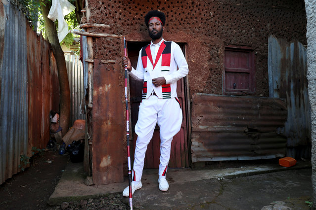 Magarsa Kanaa, a 28-year-old teacher and local leader of Oromo youths, poses for a portrait in front of his house in the town of Woliso, Oromia region, Ethiopia, October 21, 2018. (Photo by Tiksa Neger/Reuters)