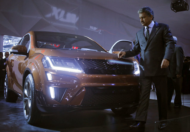Chairman and managing director of Mahindra & Mahindra, Anand Mahindra walks past a newly launched Mahindra XUV Aero concept car at the Indian Auto Expo in Greater Noida, on the outskirts of New Delhi, India, February 4, 2016. (Photo by Anindito Mukherjee/Reuters)