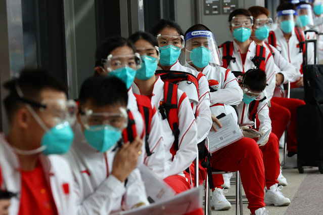 Members of China's Olympic team wear face masks and face shields during the quarantine process after arriving at Narita International airport on July 19, 2021, ahead of the Tokyo 2020 Olympic Games. (Photo by Kim Kyung-Hoon/Reuters)