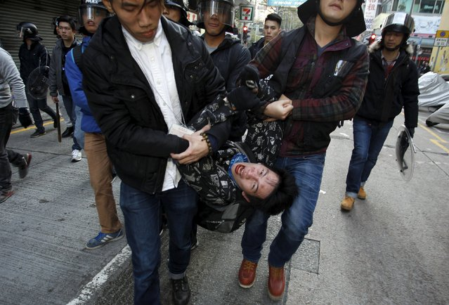 A protester shouts as he is arrested by plainclothes policemen after a clash at Mongkok district in Hong Kong, China February 9, 2016. (Photo by Liau Chung-ren/Reuters)
