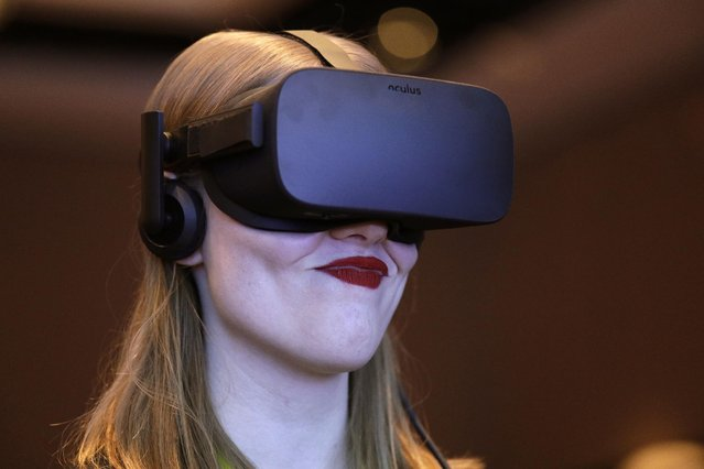 Meghan Puhr participates in a virtual realty presentation during an Intel news conference before CES International, Wednesday, January 4, 2017, in Las Vegas. (Photo by John Locher/AP Photo)