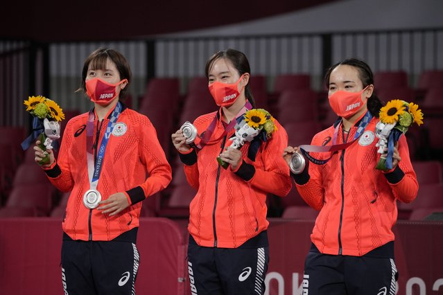 From left, silver medalists Miu Hirano, Kasumi Ishikawa, and Mima Ito of Japan pose with their medals during the medal ceremony for women's team table tennis at the 2020 Summer Olympics, Thursday, August 5, 2021, in Tokyo. (Photo by Kin Cheung/AP Photo)
