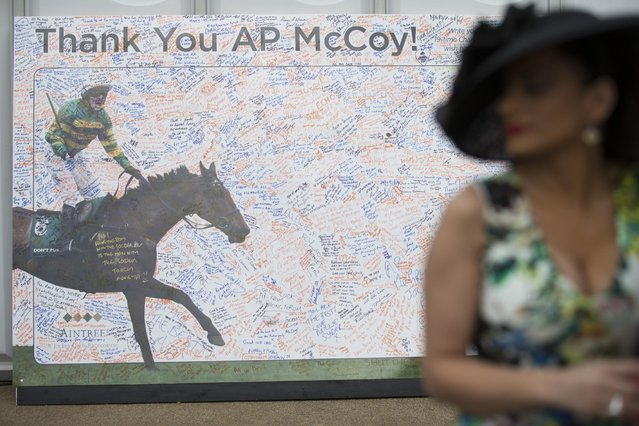 A thank you message board to retiring Jockey AP McCoy is displayed during Aintree race meeting's Ladies Day the day before the Grand National horse race at Aintree Racecourse Liverpool, England, Friday, April 10, 2015. (Photo by Jon Super/AP Photo)