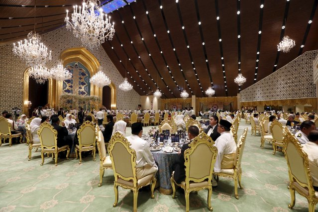 Guests at the wedding banquet for Brunei's newly wed royal couple, Prince Abdul Malik and Dayangku Raabi'atul 'Adawiyyah Pengiran Haji Bolkiah, at the Nurul Iman Palace in Bandar Seri Begawan April 12, 2015. (Photo by Olivia Harris/Reuters)