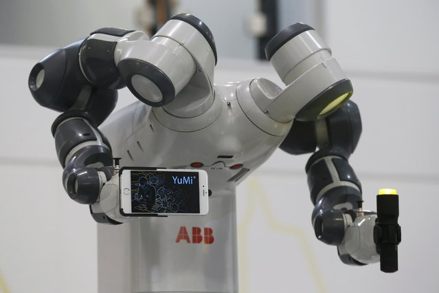 A YuMi robotic arm is pictured at the world's largest industrial technology fair, the Hannover Messe, in Hanover April 13, 2015. (Photo by Wolfgang Rattay/Reuters)