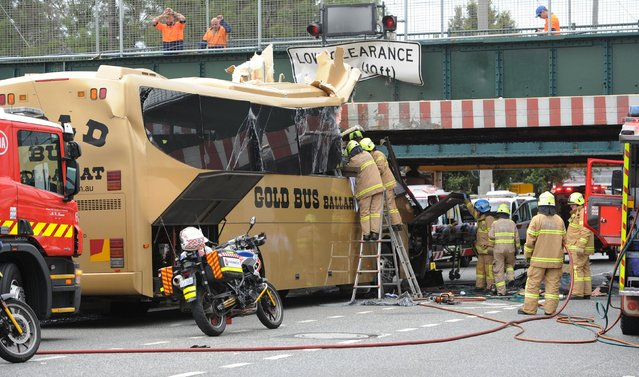 Emergency workers work at the scene where a bus crashed into an overhead barrier protecting a low bridge in South Melbourne, Australia February 22, 2016. (Photo by Mal Fairclough/Reuters/AAP)