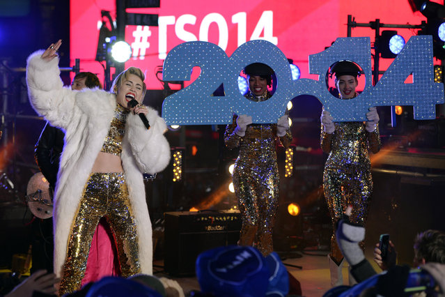Miley Cyrus performs as thousands of revelers gather in New York's Times Square to celebrate the ball drop at the annual New Year's Eve celebration on December 31, 2013  in New York City. (Photo by Timothy A. Clary/AFP Photo)
