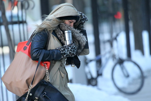 January 6, 2014  Photographs of the cold in and around Milwaukee.  Here people make their way as best they can around the downtown area between office buildings and heading to work. (Photo by Michael Sears/Milwaukee Journal Sentinel)