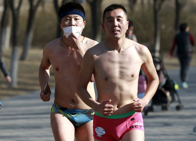 "A participant wearing a facial mask runs in the ""Half-Naked Marathon"" at Olympic Forest park in Beijing, China, February 28, 2016 (Photo by Kim Kyung-Hoon/Reuters)"