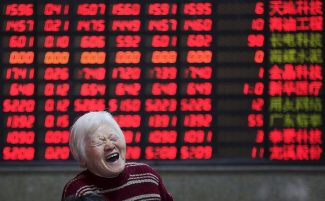 An investor reacts in front of an electronic board showing stock information at a brokerage house in Shanghai, China, March 7, 2016. (Photo by Aly Song/Reuters)