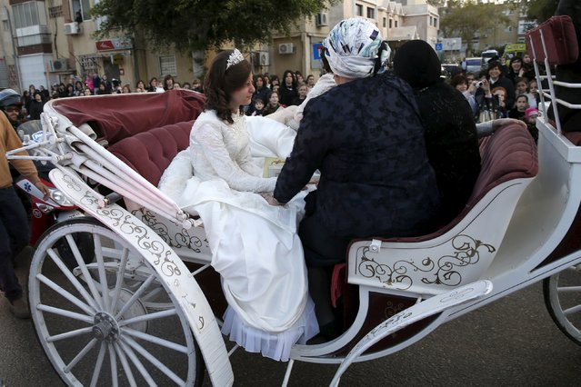 An ultra-Orthodox Jewish bride arrives to her wedding ceremony on a carriage in Netanya, Israel March 15, 2016. (Photo by Baz Ratner/Reuters)