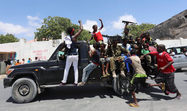 Somali military and civilians celebrate the election of President Mohamed Abdullahi Mohamed in the streets of Somalia's capital Mogadishu, February 9, 2017. (Photo by Feisal Omar/Reuters)